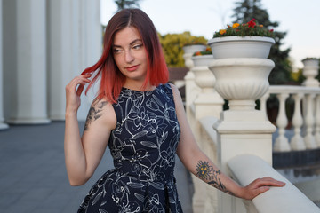 red haired beauty  girl in dress walk in the park