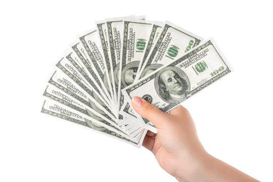 Hand holding money hundred dollar bank notes isolated on white
