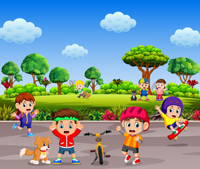the children are playing and doing sport together in the road