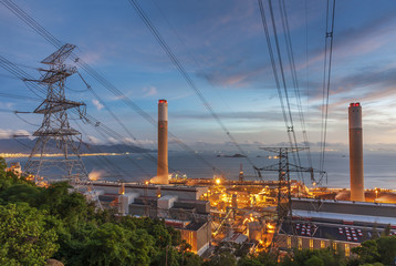 Power plant and electric pylon at dusk