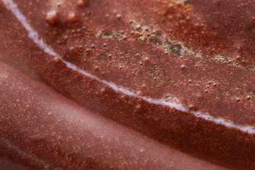 Chocolate close-up background of melted dessert in a brown tone.