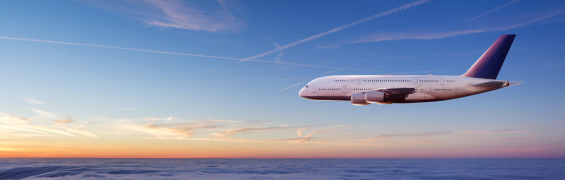Huge two-storey passengers airplane flying above clouds