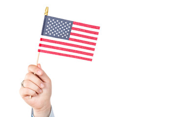 Woman hand holding american flag of the USA with stars and stripes isolated on white background