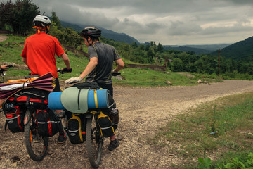 Bicyclists on the rural road in Abkhazia