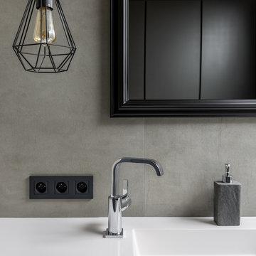 Gray bathroom with black mirror