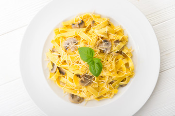 Tagliatelle pasta with cheese and mushrooms