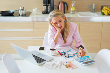 Stressed woman having financial problems and bills to pay