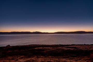 The shore of lake Tekapo in New Zealand