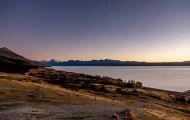 Sunset at the shore of lake Tekapo in New Zealand