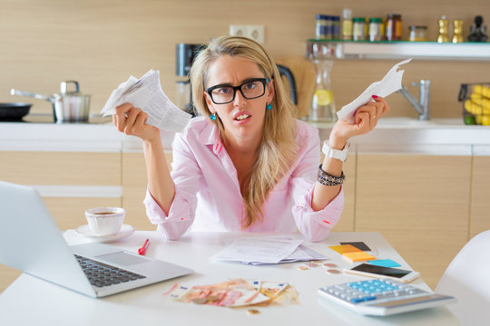 Desperate woman with too many bills to pay