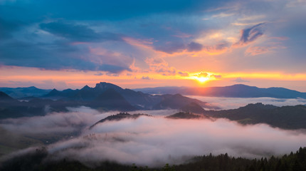 wonderful, beautiful sunset in the mountains. The fogs were illuminated by the setting sun