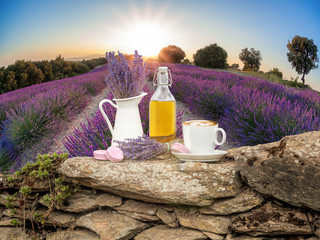 Lavender still life with cup of coffee against fields in Provence, France
