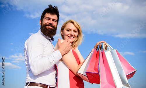 5c9317e978 Family bought excellent clothes. Couple with luxury bags hugs blue ...