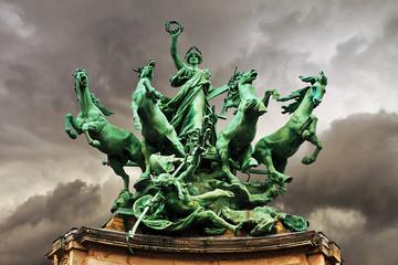 Quadriga statue on top of the Grand Palais in Paris. L'Immortalite devancant le Temps