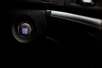 Detail on the start button in a car. Car interior, key, start&st