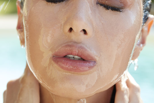 asian woman having a shower after a swimmingpool mouth detail