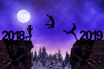 Silhouette the girls jump to the New Year 2019 in night