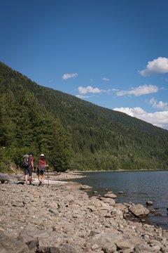 Couple walking near riverside