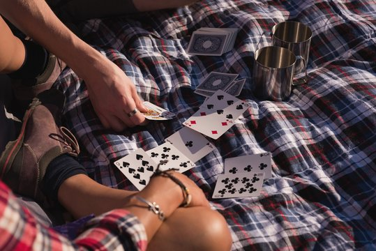 Couple playing with playing cards