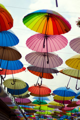 street  decoration with bright umbrellas against the sky