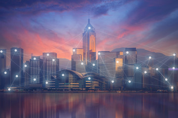 Business and technology concept on modern city skyline on beautiful sunset sky prime time with busy connection activities.
