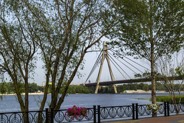 Kyiv, Ukraine - September 6, 2018: North Bridge which connecting left and right side of Kyiv. View from Natalka park.