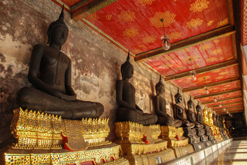Golden Buddha images from Wat Suthat Thepwararam, Beautiful temple architecture , Bangkok, Thailand
