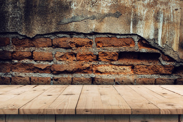 Brick wall background and empty wooden table display montage for product with copy space.