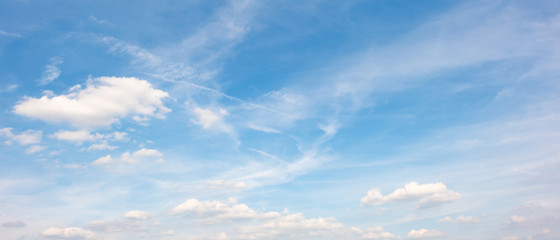 White clouds on a blue sky as background