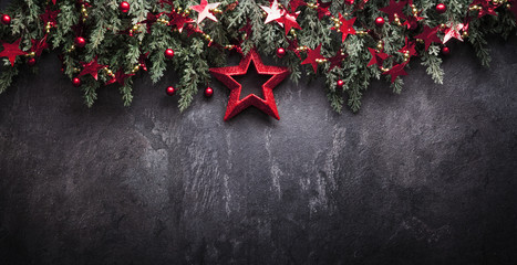 Christmas Decoration With Fir Branches and Red Berries On a Dark Background