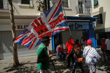 A man waves a flag during the Gibraltar National Day celebrations, in the British overseas territory of Gibraltar