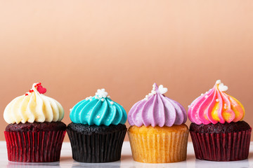 variety colorful cute cupcake on pink background