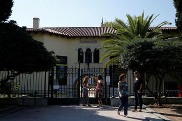 People exit the Byzantine Museum in Athens