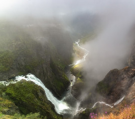 Landscape with waterfall, river and mountain, Norway.
