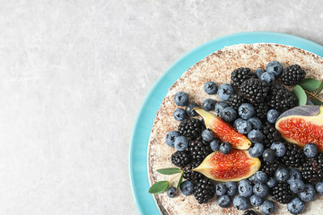 Delicious homemade cake with fresh berries and space for text on table, top view