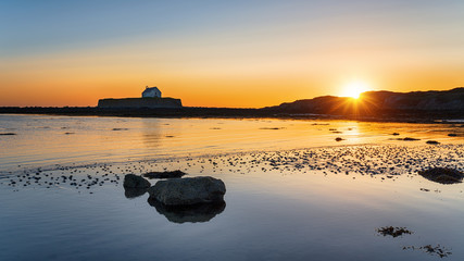 Wall Mural - Sunset over Cwyfan Church in Wales