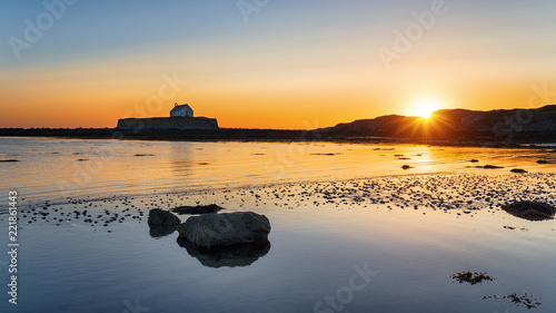 Wall mural Sunset over Cwyfan Church in Wales