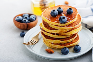 Classic american pancakes with fresh berry and honey.
