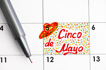 Reminder Cinco de Mayo in calendar with pen.