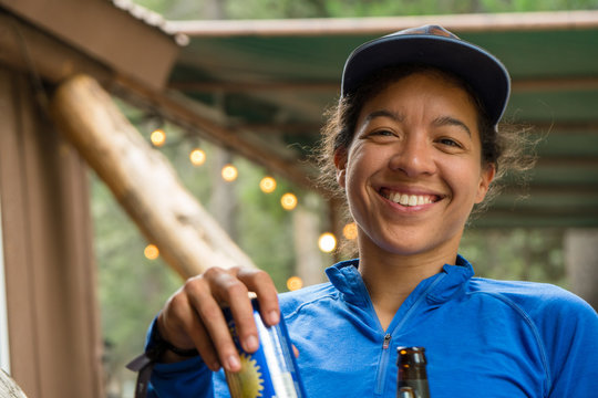 Smiling mixed race woman in the outdoors in a hunting lodge