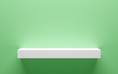 empty white shelf on green wall with light from the top