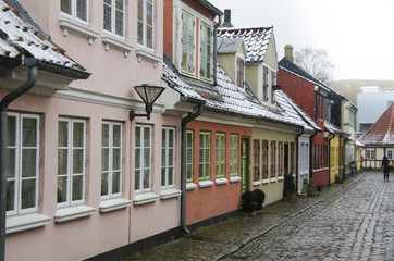 Old houses in Hans Christian Andersens quarter in the danish snow weather