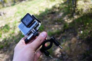 Action camera to capture your videos. Suitable for car travel, sports, diving, Cycling and other Hiking