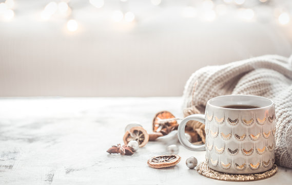 cozy winter composition with a cup and sweater