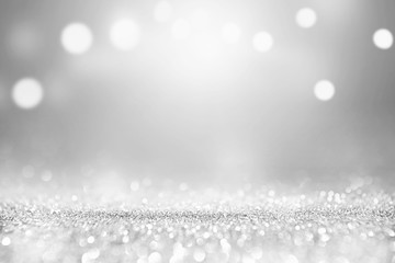 White silver glitter and grey lights bokeh with stars abstract background holiday.
