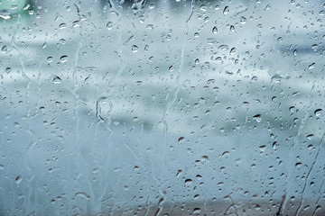 Car windshield covered in raindrops/texture background