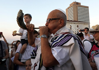 Jews pray while performing the Tashlich ceremony, on the beach in the central Israeli town of Tel Aviv