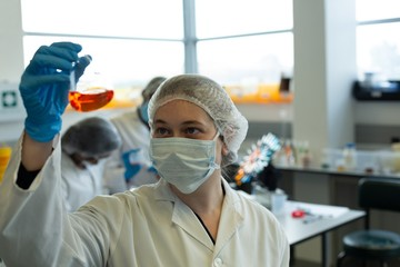 Female scientist experimenting in laboratory