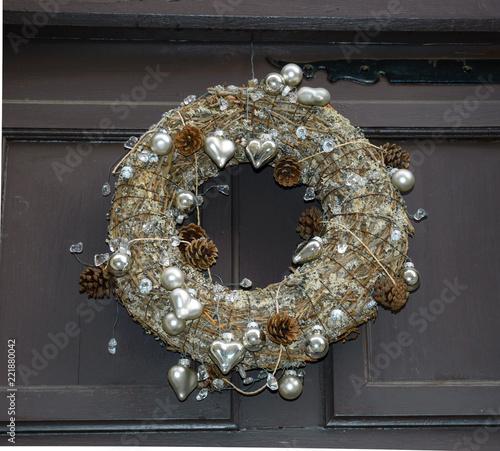 Death Concept Faded Christmas Wreath On A House Door Stock Photo