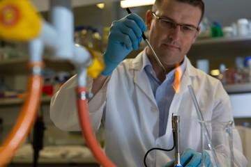 Male scientist experimenting in laboratory